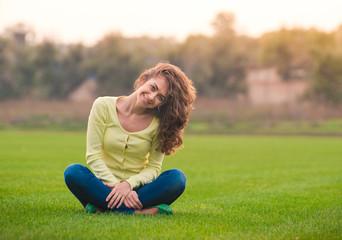 Beautiful girl smiling happy  looking at camera in lotus pose