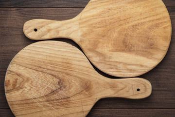 two handmade breadboards on table