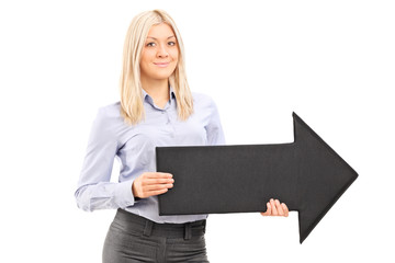 Blond smiling woman holding a big black arrow pointing right