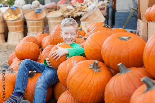 kid at pumpkin patch - 80340816