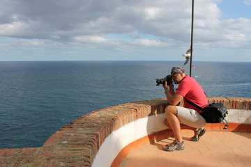 Photographer at work, landscape photography outdoor.