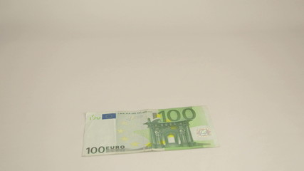 100 Euro bill drops off the table
