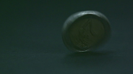 The 2 Euro coin twirls on the table