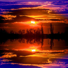 red sunset over lake surface