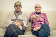 old couple watching tv - 80344017