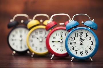 Clock. Retro alarm clocks on a table. Photo in retro color image