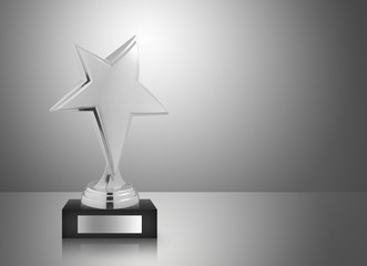 Golden star trophy on gray background