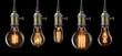 Leinwandbild Motiv Set of vintage glowing light bulbs on black