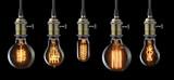 Fototapety Set of vintage glowing light bulbs on black