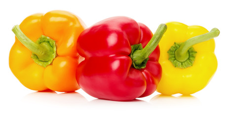 red, yellow and orange peppers isolated on the white background