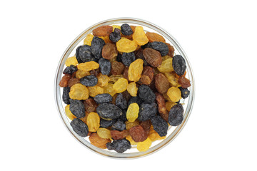 mixture of raisins in a glass cup on a white background