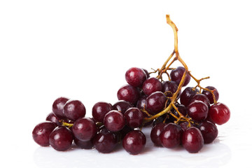 Fresh red grapes and water drops isolated on white background