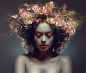 Creative beauty portrait with pink wraith in hair