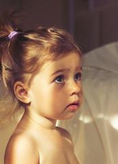 Toned portrait of Little cute girl is afraid