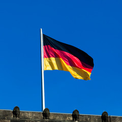 Silky flag of Germany flying in the wind.  German flag on the to