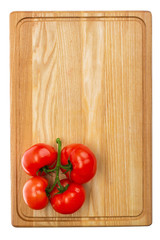 a bunch of fresh tomatoes on a wooden cutting board
