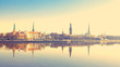 Leinwanddruck Bild - Riga center with reflection in Daugava, with retro filter effect