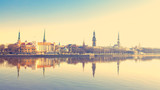 Riga center with reflection in Daugava, with retro filter effect