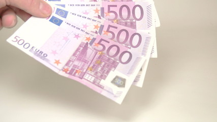 4 500 Euro bills dropped by the hand