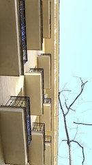 rectangular balconies and sky from the street