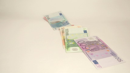 Few Euro bills dropping off the table