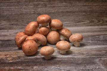Brown champignon mushrooms on the table