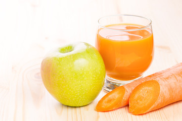 Glass of fresh carrot and apple juice