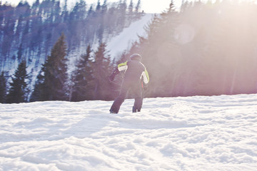 A snowboarder descends from the mountain