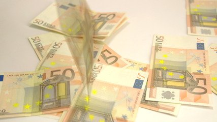 Many 50 Euros thrown on the floor
