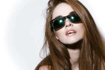 Studio portrait of young girl with sunglasses
