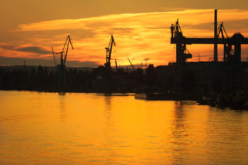 Big shipyard crane at sunset in Gdansk, Poland.