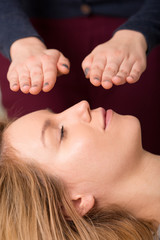 Woman in reiki healing session