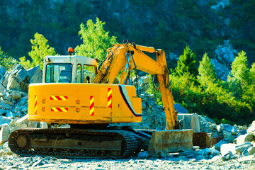 yellow excavator, digger on construction site