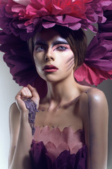 Creative beauty shot with pink headdress