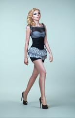 Studio portrait of pretty woman in dress