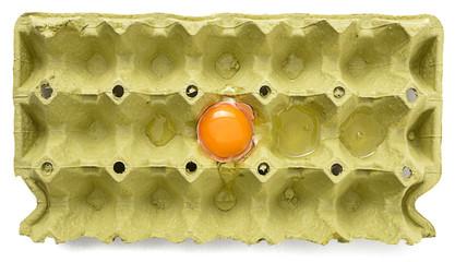 Broken Egg in Cardboard
