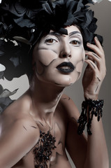 Creative beauty shot with black and white headdress
