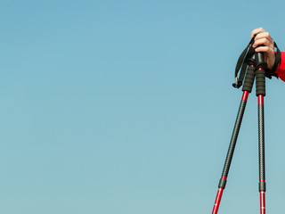 Nordic walking. Red sticks on blue sky background