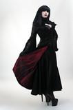 Medieval vampire girl in black red dress