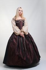 Girl in medieval beautiful dress