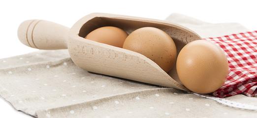 Organic Eggs in Wooden Spoon