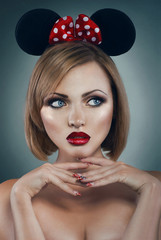 Pretty young woman with miuse ears and red bow