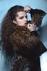 Woman in leopard coat