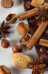 Chocolate and nuts with cinnamon sticks, star anise