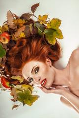 Beauty portrait with autumn leaves