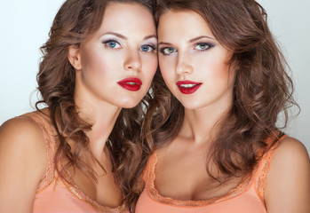 Two pretty womans with red lips