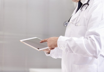 Doctor working with a digital tablet