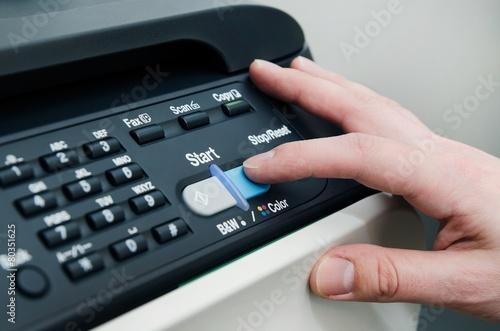Finger on start button of laser printer - 80351625