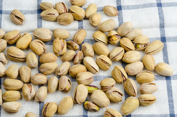 roasted and salted pistachios on table cloth