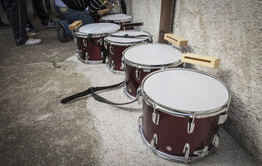 music band and several lined up drums outdoors
